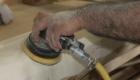 Rustic shuffleboard table hand sanding