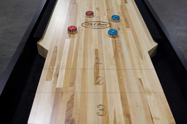 How Rebound Shuffleboard Compares To Regular Table ShuffleboardMcClure  Tables