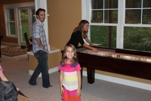 Family Fun on a shuffleboard table