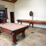 Gameroom Shot Antique Brunswick Arcadia Pool Table and McClure Handcrafted Shuffleboard
