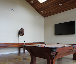Spacious attic shuffleboard table gameroom desgins